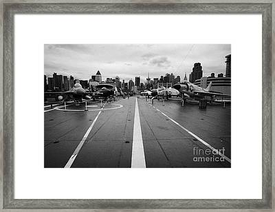 Aircraft On The Flight Deck Of The Uss Intrepid Looking Towards Manhattan New York Framed Print by Joe Fox