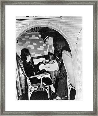 Airline Steward Serves Woman Framed Print by Underwood Archives