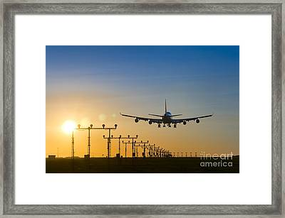 Airplane Landing At Sunset, Canada Framed Print by David Nunuk