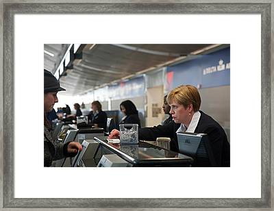 Airport Check-in Desk Framed Print by Jim West