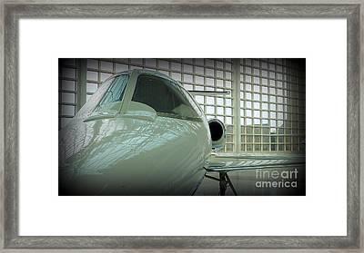 Alabaster Lear Jet Framed Print by Susan Garren