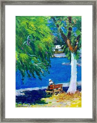 Alone At The Beach Framed Print by George Siaba