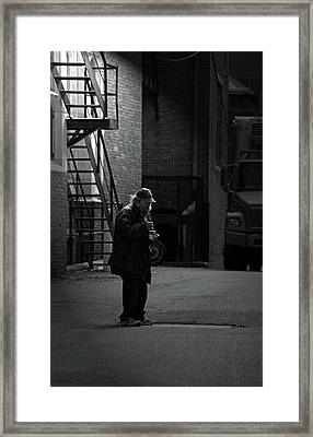 Alone In The Streets Framed Print by Karol Livote