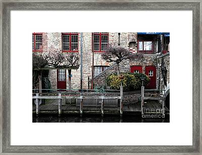 Along The Canal Framed Print by John Rizzuto