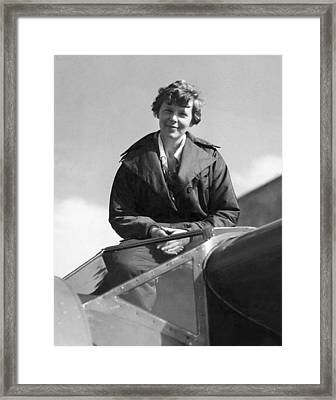 Amelia Earhart In Cockpit Framed Print by Underwood Archives