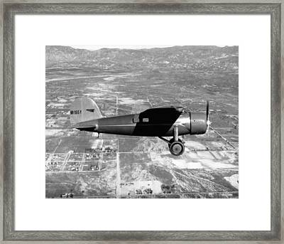 Amelia Earhart In Her Plane Framed Print by Underwood Archives