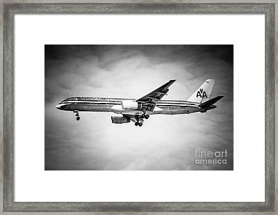 Amercian Airlines Airplane In Black And White Framed Print by Paul Velgos
