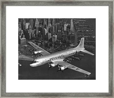 American Dc-6 Flying Over Nyc Framed Print by Underwood Archives