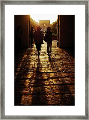 American Tourists Silhouetted Framed Print by Adam Jones