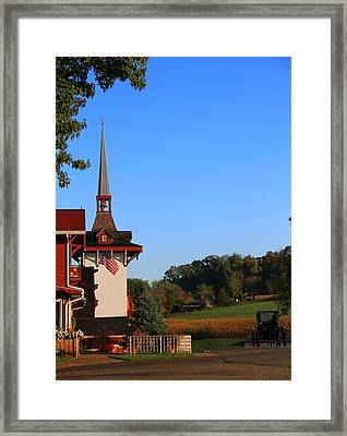 Amish Buggy And Church Framed Print by Dan Sproul