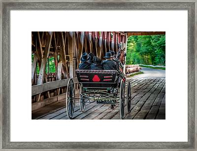 Amish Family On Covered Bridge Framed Print by Gene Sherrill