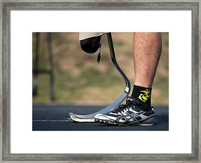 Amputee Sprinter Framed Print by Us Air Force/mark Fayloga