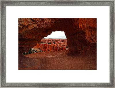 An Arch Foreground The Pillars Framed Print by Jeff Swan