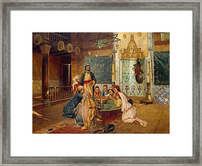 An Eastern Meal Framed Print by Rudolphe Ernst