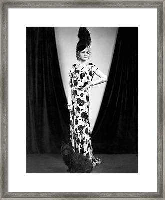 An Elegant Woman Poses With Her Dog. Framed Print by Underwood Archives