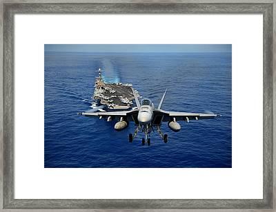 An F/a-18 Hornet Demonstrates Air Power. Framed Print by Sebastian Musial