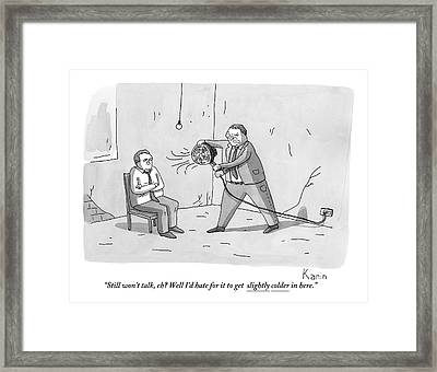 An Interrogation Officer Points A Small Fan Framed Print by Zachary Kanin