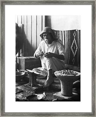 An Iraqi Silversmith At Work Framed Print by Underwood Archives