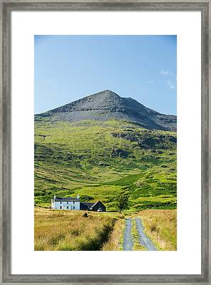 An Isolated House Beneath Ben More Framed Print by Ashley Cooper