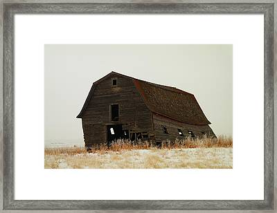 An Old Leaning Barn In North Dakota Framed Print by Jeff Swan
