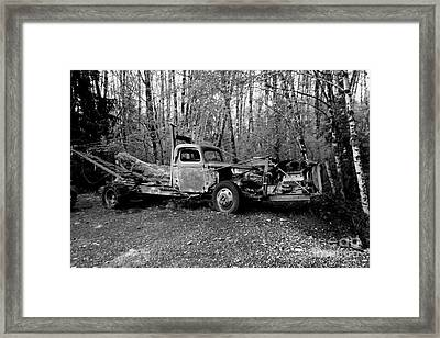 An Old Logging Boom Truck In Black And White Framed Print by Jeff Swan