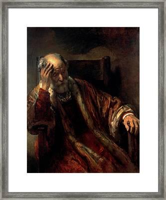 An Old Man In An Armchair Framed Print by Rembrandt Harmensz van Rijn