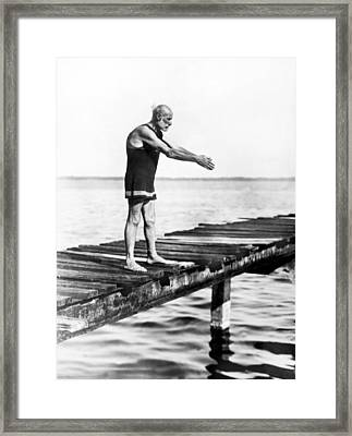 An Old Man Prepares To Dive Framed Print by Underwood Archives
