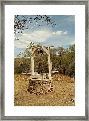 An Old Well In Lincoln City New Mexico Framed Print by Jeff Swan
