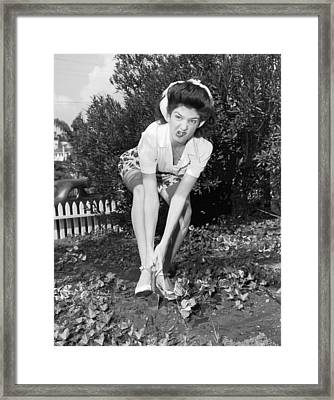 An Unhappy Gardener Framed Print by Underwood Archives