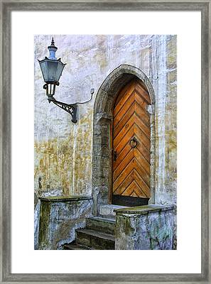 Ancient Door In Estonia Framed Print by Linda Phelps