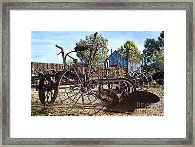 Antique Farm Equipment End Of Row Framed Print by Lee Craig
