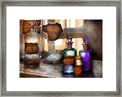 Apothecary - Oleum Rosmarini  Framed Print by Mike Savad