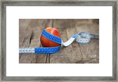 Apple And Measuring Tape Framed Print by Aged Pixel