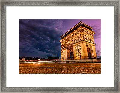 Arc De Triomphe At Dusk In Paris Framed Print by James Udall