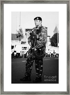 Armed British Soldier On Crumlin Road At Ardoyne Shops Belfast 12th July Framed Print by Joe Fox