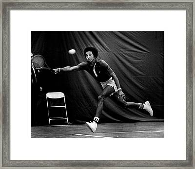 Arthur Ashe Returning Tennis Ball Framed Print by Retro Images Archive