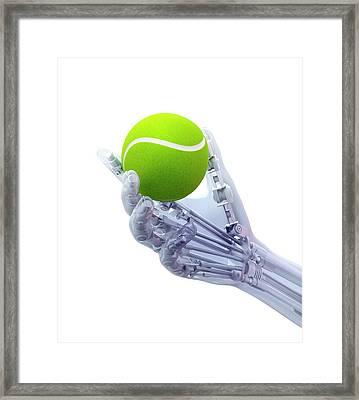 Artificial Hand Holding A Tennis Ball Framed Print by Andrzej Wojcicki
