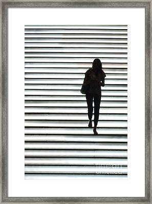 Artistic Silhouette Girl Walking Down Framed Print by Lars Ruecker