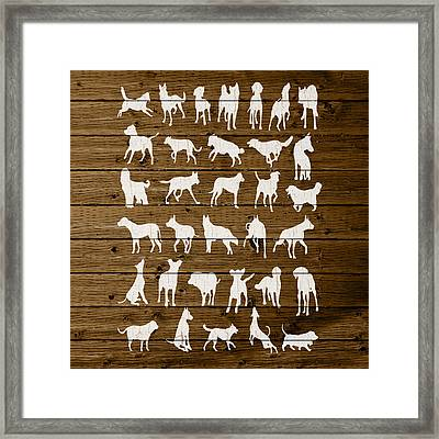 Assorted Dog Species Outline White Distressed Paint On Reclaimed Wood Planks Framed Print by Design Turnpike