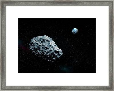 Asteroid Approaching Earth Framed Print by Mikkel Juul Jensen