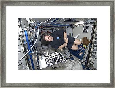 Astronaut Chess Game On The Iss Framed Print by Science Photo Library
