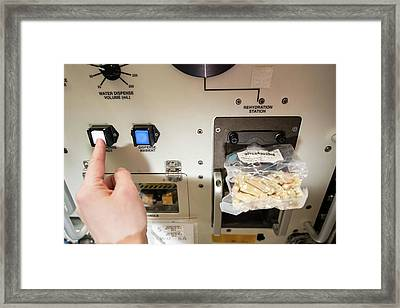 Astronaut Preparing Lunch On The Iss Framed Print by Nasa