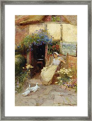 At The Cottage Door Framed Print by Thomas Mackay