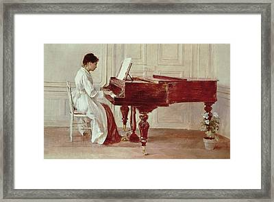 At The Piano Framed Print by Theodore Robinson