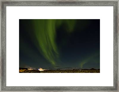 Aurora Borealis Over Iceland Framed Print by Andres Leon