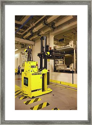 Automated Forklift At A Car Factory Framed Print by Jim West