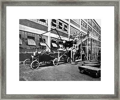 Automobile Assembly Line Framed Print by Underwood Archives