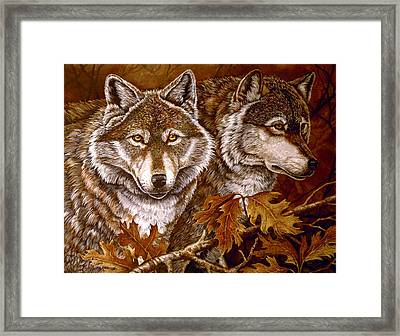 Autumn Wolves Framed Print by Sandy Williams