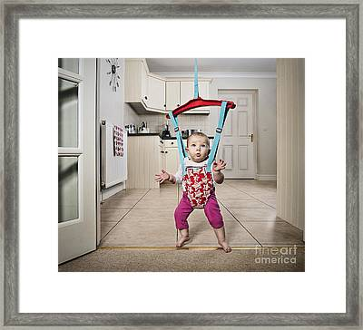Baby Bouncer Framed Print by Justin Paget