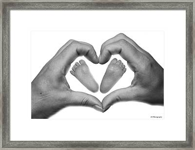 Baby Feet In Mothers Hand Framed Print by Jay Harrison